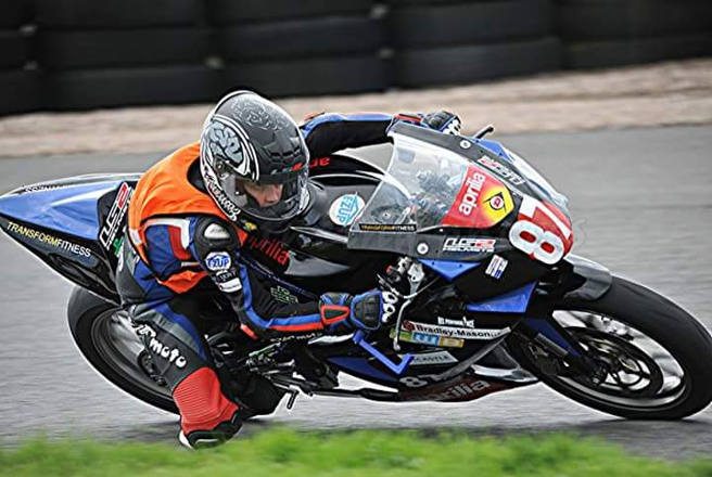 Corporate responsibility - Jake Hopper racing on his motorbike